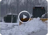 Skid steer pushing snow